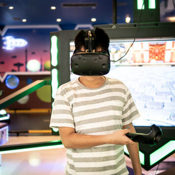 Man in VR booth