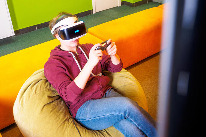 Person playing PSVR seated