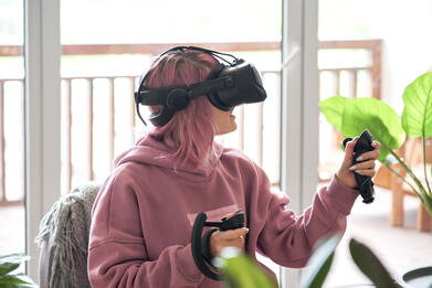 Woman in VR with headset and controllers