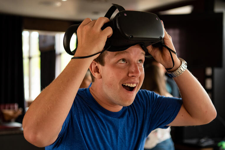 Man tries a virtual reality headset