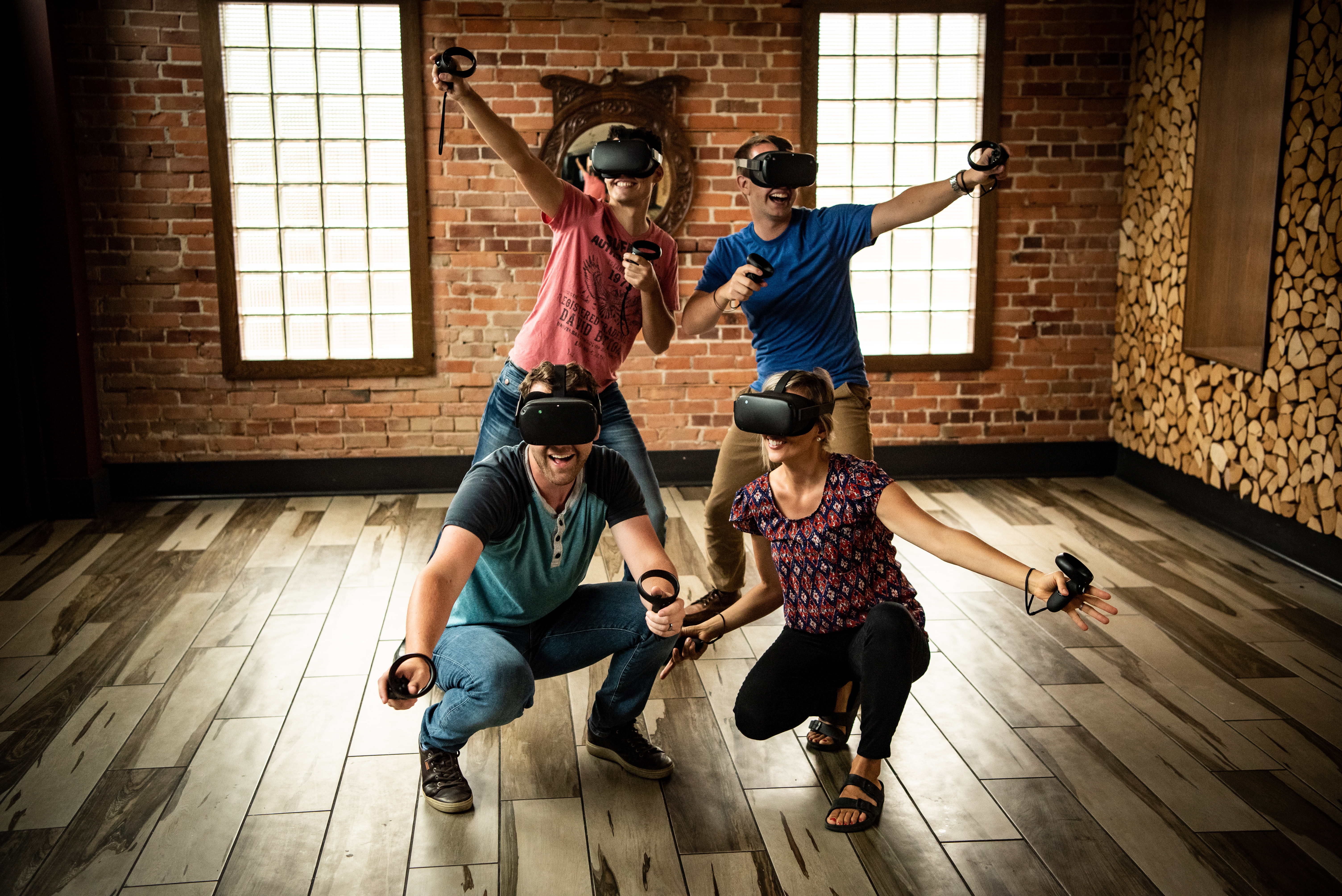 Group of four customers trying VR with Oculus Quest headsets