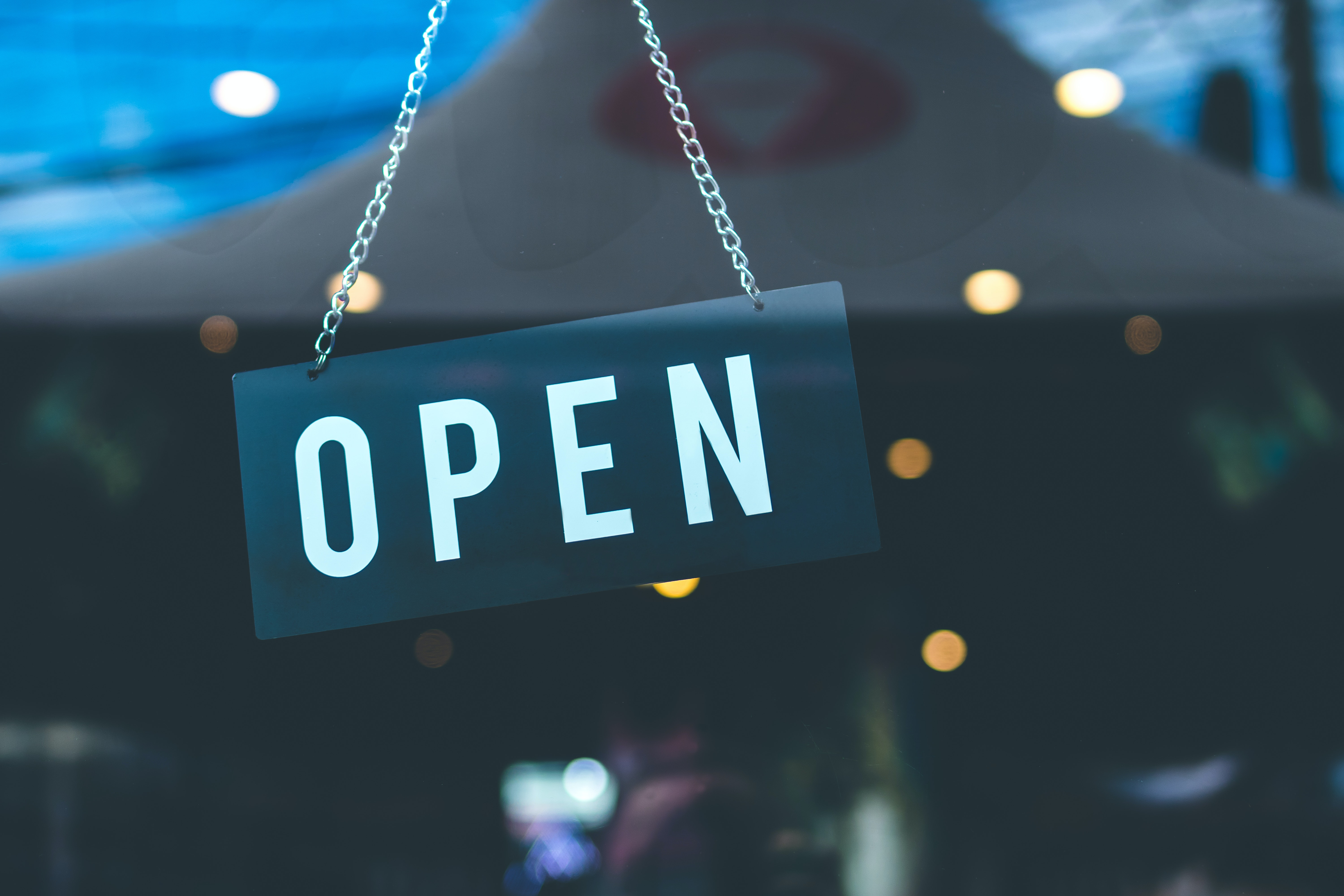 Business reopening with open sign in window